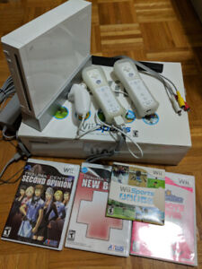 Nintendo Wii + extra controller + games  + homebrew