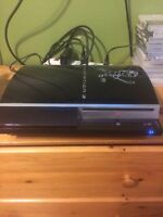 PS3 with 12 games and 3 controllers