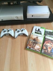 Xbox 360 + 2 manettes + jeux