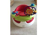 Mamas & Papas snug seat in raspberry with play tray