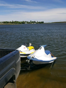 2 watercrafts with trailer