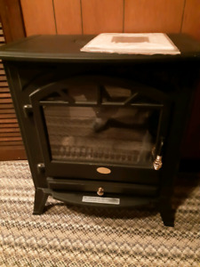 Electric fireplace with manual