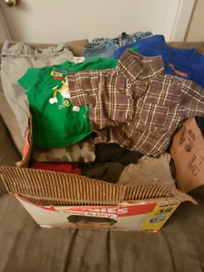 Two boxes of 9-12 month boys clothing