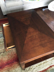 Wooden coffee table with a drawer and wheels