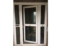PVC door including side window panels