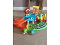 Vtech toot garage with 2 vehicles