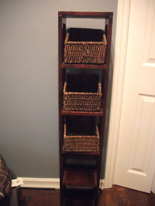 Dark wood shelving unit with baskets