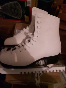 2 pairs of figure skates for sale