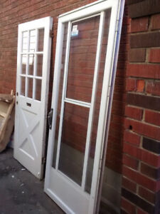 Solid wood antique door with 9 small windows & glass storm door