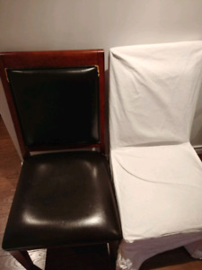 four wood and faux leather dining chairs