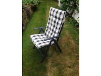 Pair of identical garden chairs
