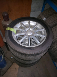 4 Mags with Winter Tires 235/50R17 5X115 Cadillac STS