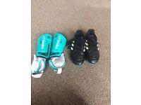 Boys adidas football boots and shin pads.