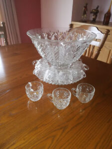 Glass Punch Bowl with stand and 12 glasses.