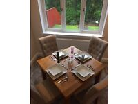 Stunning oak dining table and chairs