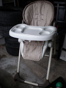 HIGH CHAIR LEFT BEHIND IN STORAGE LOCKER...