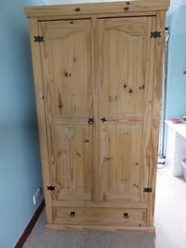 Pine double door wardrobe with drawer at the bottom