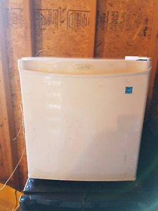 Mini Bar Fridge White Look and Works Great  Approx 5 years old.