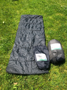Two sleeping bags with carrying bags