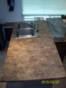 Countertop and stainless steel kitchen sink/faucet