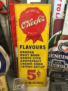 Antique Okeefes metal pop sign