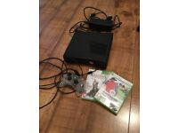 Xbox 360 slim with control pad and games