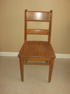 Two marching classic wooden office chairs