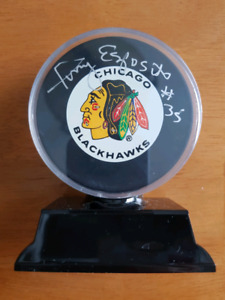 Tony & Phil Esposito autographed hockey pucks