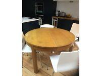 IKEA Bjursta extendable round dining table, oak veneer.