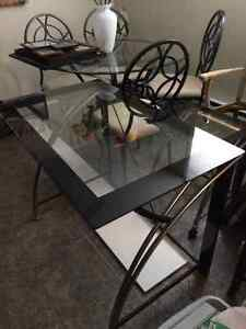 Glass top desk with printer stand. Black desk chair.