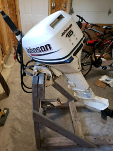 15hp Johnson Outboard/14ft fiberglass boat with trailer.