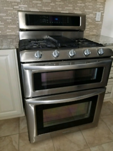 Kitchen aid double oven gas stove.
