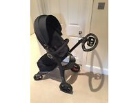 Stokke XPlory V4 Black edition with iZi Go car seat and assesories