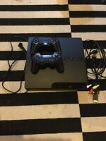 Sony PlayStation 3 with two remotes