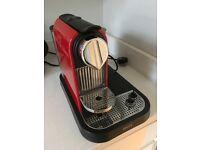 KRUPS Nespresso coffee machine in red.