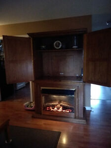 TV unit with shelving & fireplace
