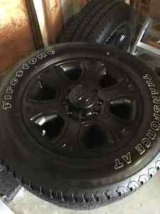 NEW Blacked out Dodge Ram Rims Firestone Transforce AT M+S tires