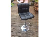 Black swivel bar stool.