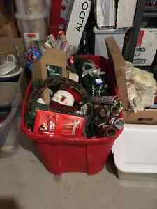 Christmas bin full of surpriwith wrap, ribbon, wreaths etc. etc.