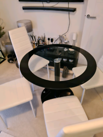 Brand new table and 4x real leather chairs