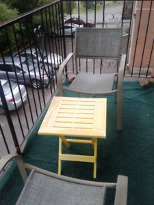 2 patio chairs and plastic folding table