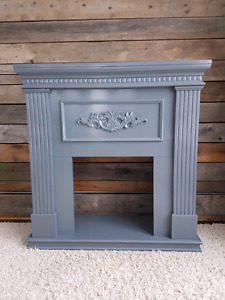 Grey fireplace mantle