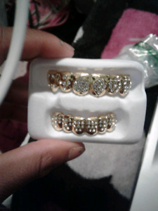 Gold plated grills with diamonds