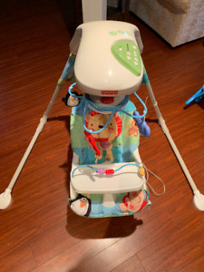 Fisher Price Swing and a Fisher Price Rocking/Vibrating Chair