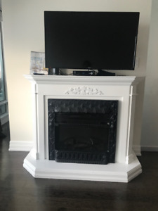 Electric fireplace with wooden mantle