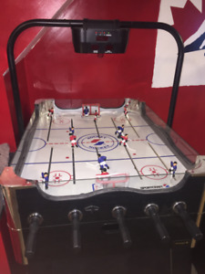 Bubble Hockey with heavy wooden pucks and electric plug