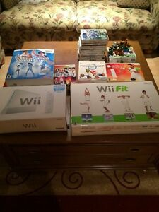 Wii for sale with 2 joysticks controls all games and wii fit