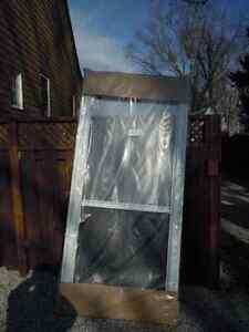 Storm door, NEW, 36x84, white, left handle, bottom up glass