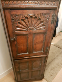 Corner dark wood cabinet