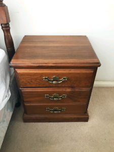 A pair of solid wooden bedside tables